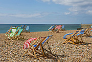 Empty deckchairs on the beach, Brighton sea front