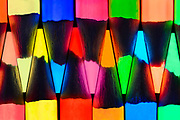 An arrangement of glowing pencils.  Blacklight Photography