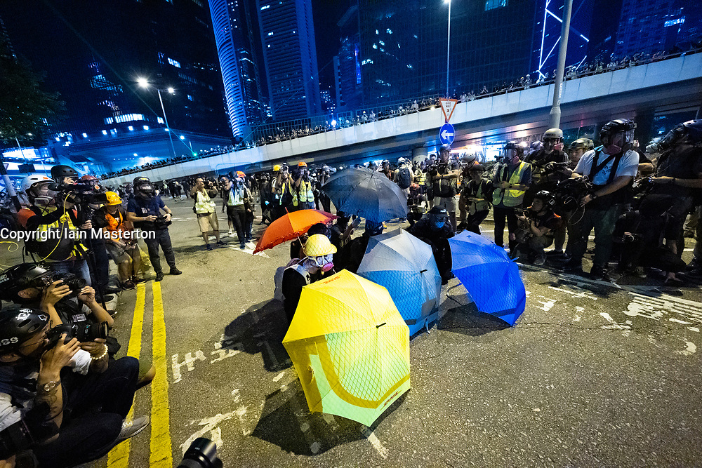 Central, Hong Kong. 29 September, 2019. Rally by thousands of pro-democracy supporters at Central Government offices at Tamar Park to mark the 5th anniversary of the start of the Umbrella Movement. Activists provoke police by throwing stones. Response was police use of water cannon. Iain Masterton/Alamy Live News.