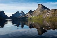 Reflection of Segltind mountain peak rising from Kirkefjord, near Reine, Moskenesøy, Lofoten Islands, Norway