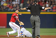 ATLANTA, GA - JUNE 08:  Shortstop Andrelton Simmons #19 of the Atlanta Braves argues a call by second base umpire Chris Conroy #98 while left fielder Rajai Davis #11 of the Toronto Blue Jays slides in safely during the game at Turner Field on June 8, 2012 in Atlanta, Georgia.  (Photo by Mike Zarrilli/Getty Images)