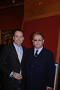 David Furnish and Sir Elton John. 4 Inches, A  Photographic Auction in aid of the Elton John Aids Foundation hosted by Tamara Mellon and Arnaud Bamberger. Christie's. 8 King St. London. 25 May 2005. ONE TIME USE ONLY - DO NOT ARCHIVE  © Copyright Photograph by Dafydd Jones 66 Stockwell Park Rd. London SW9 0DA Tel 020 7733 0108 www.dafjones.com
