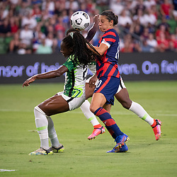 USA forward CARLI LLOYD (10) takes on Nigeria's MICHELLE ALOZI (22) during the second half of the US Women's National Team (USWNT) 2-0 victory over Nigeria, in the first match at Austin's Q2 Stadium. The U.S. women's team, an Olympic favorite, is wrapping up a series of summer matches to prep for the Tokyo Games. Press scored a goal in the win for USA Soccer.