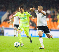Valencia's Sofiane Feghouli and KAA Gent's Danijel Milicevic during Champions league match. October 20, 2015. (ALTERPHOTOS/Javier Comos)