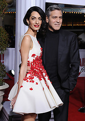 """File photo : George Clooney and Amal Clooney attend Universal Pictures Hail, Caesar! premiere at Regency Village Theatre on February 1, 2016 in Los Angeles, CA, USA. Amal Clooney and her husband George are expecting twins, US media report. The babies are due in June, according to CBS's The Talk host Julie Chen. Another source close to the couple, quoted by People, said they were """"very happy"""". The Clooneys' representatives have not yet commented. Photo by Lionel Hahn/ABACAPRESS.COM"""
