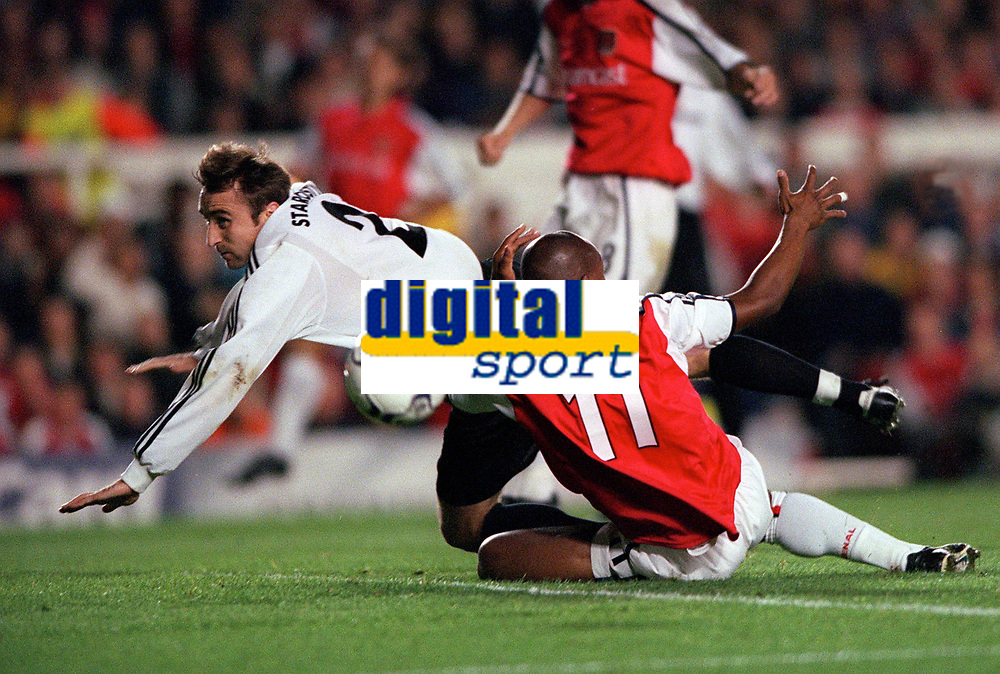 Sylvian Wiltord is tripped by  Donetsk defender Mykhaylo Starostyak for the Arsenal penalty. Arsenal 3:2 FC Shakhar Donetsk, UEFA Champions League, Group B, 20/9/2000. Credit Colorsport / Stuart MacFarlane.