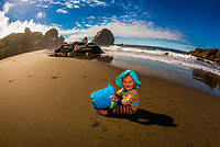 11 month boy playing on the beach at Harris Beach State Park, Brookings, Oregon USA.
