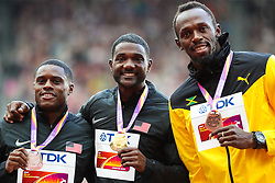 London, 2017 August 06. Men's 100m medalists Christian Coleman (silver), Justin Gatlin (gold) and Usain Bolt (bronze) pose with their medals on the podium on day three of the IAAF London 2017 world Championships at the London Stadium. © Paul Davey.