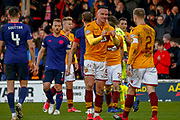 Tom Aldred of Motherwell congratulates team mate Richard Tait of Motherwell following their late winner during the Ladbrokes Scottish Premiership match between Motherwell and Heart of Midlothian at Fir Park, Motherwell, Scotland on 17 February 2019.
