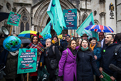 © Licensed to London News Pictures. 27/02/2020. London, UK. Liberal Democrat MP for Richmond Park Sarah Olney (4-L) celebrates with Friends of the Earth staff and supporters outside the High Court after judges ruled that the planned expansion of Heathrow Airport was illegal over climate change. Photo credit: Rob Pinney/LNP