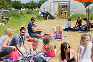 20140601 Free for editorial use image<br /> <br /> Halifax colleagues in Bournemouth are proud to give extra back to their local community by hosting their Big Lunch event on Sunday 01 June 2014.<br /> <br /> Halifax Branch Manager David Farmer plays guitar during The Big Lunch at the New Leaf Allotment in Bournemouth. <br /> <br /> For more information please contact: Catherine Eastham on 020 3697 4304<br /> <br /> If you require a higher resolution image or you have any other onEdition photographic enquiries, please contact onEdition on 0845 900 2 900 or email info@onEdition.com<br /> This image is copyright the onEdition 2014©.<br /> This image has been supplied by onEdition and must be credited onEdition. The author is asserting his full Moral rights in relation to the publication of this image. Rights for onward transmission of any image or file is not granted or implied. Changing or deleting Copyright information is illegal as specified in the Copyright, Design and Patents Act 1988. If you are in any way unsure of your right to publish this image please contact onEdition on 0845 900 2 900 or email info@onEdition.com