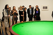 LILY COLE; INDIA WATERS; ILLY FRAITURE,  PLAYING Gabriel Orozco's 'Carambole with a Pendulum?  (an oval-shaped billiard table with no pockets ), Gabriel Orozco reception, Tate Modern, London. 18 January 2010. .-DO NOT ARCHIVE-© Copyright Photograph by Dafydd Jones. 248 Clapham Rd. London SW9 0PZ. Tel 0207 820 0771. www.dafjones.com.