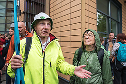 © Licensed to London News Pictures. 19/07/2019; Bristol, UK. Extinction Rebellion Summer Uprising 2019. Roger from Exeter, who was arrested twice on Wednesday but the dearrested by police, attends Bristol Magistrates Court in support of 16 people who are appearing at court after being arrested on Wednesday when they blocked a major road junction at the end of the M32 into Bristol which caused major traffic disruption. Campaigners locked themselves onto a pink bath tub, and held 7 minute roadblocks on other parts of the junction complex. Extinction Rebellion are holding a five-day 'occupation' of Bristol, by occupying Bristol Bridge in the city centre and traffic has to be diverted and carrying out other events. As part of a country-wide rebellion called Summer Uprising, followers will be holding protests in five cities across the UK including Bristol on the theme of water and rising sea levels, which is the group's focus for the South West. The campaign wants the Government to change its recently-set target for zero carbon emissions from 2050 to 2025. Photo credit: Simon Chapman/LNP.