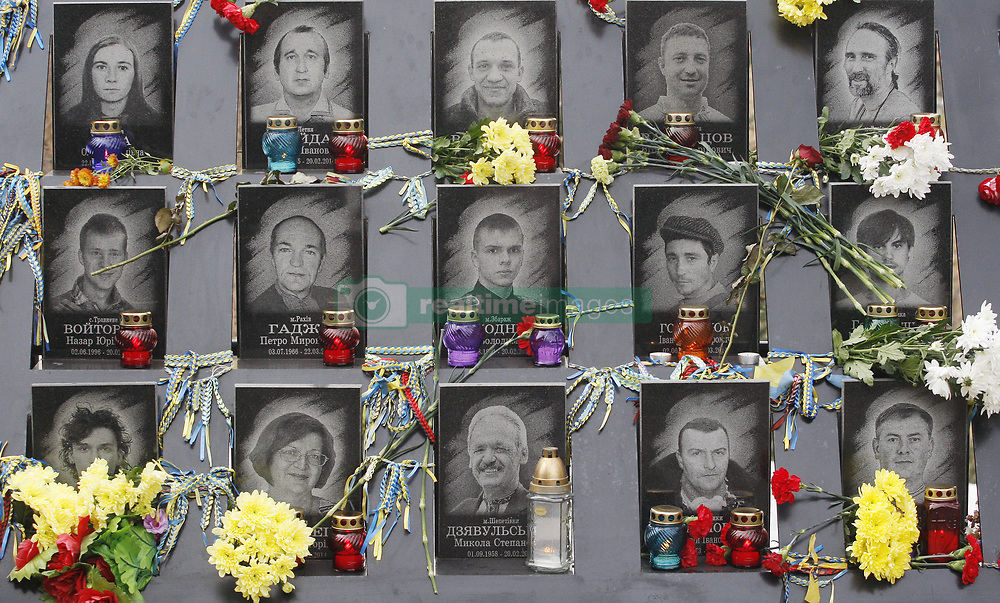 November 21, 2018 - Kiev, Kiev, Ukraine - Ukrainians lay flowers at the memorial of the EuroMaidan activists during the 5th anniversary of the Dignity Revolution in Kiev..Euromaidan Revolution or Revolution of Dignity was a wave of demonstrations and civil unrest in Ukraine, which began on the night of 21 November 2013 with public protests at the Independence Square in Kiev, demanding European integration. The protests led to the 2014 Ukrainian revolution and the ouster of President Viktor Yanukovych. (Credit Image: © Pavlo Gonchar/SOPA Images via ZUMA Wire)