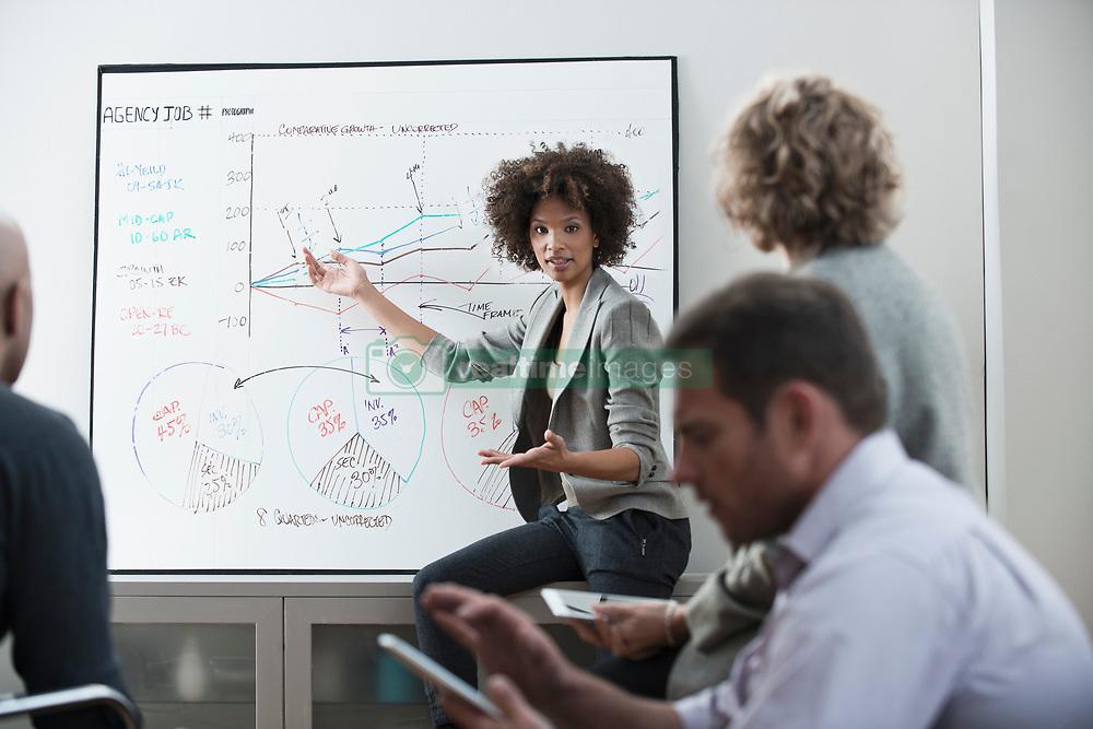 Businesswoman talking in meeting (Credit Image: © Image Source/Jose Pelaez/Image Source/ZUMAPRESS.com)