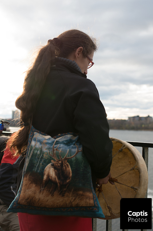 Environment activists gather at Rideau Falls after blocking traffic outside 24 Sussex. The protest was part of a four day long campaign waged by the activists to call on Canada's new Prime Minister, Justin Trudeau, to address environmental issues.