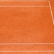 PARIS, FRANCE October 11.  A racquet and ball left on the clay court surface during the French Open Tennis Tournament at Roland Garros on October 11th 2020 in Paris, France. (Photo by Tim Clayton/Corbis via Getty Images)