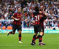Football - Premier League - Bolton vs. Manchester City<br /> Joleon Lescott of Manchester City celebrates the opening goal with goal scorer David Silva at the Reebok Stadium