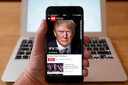Detail of iPhone smart phone showing online mobile  newspaper front-page headline from CNN following Donald Trump's victory in 2016 US Presidential Election