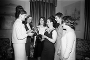 16/2/1966<br /> 2/16/1966<br /> 16 February 1966<br /> <br /> Viewing the Beamish and Carling Trophy With Admiration at the All Ireland Judo Championships Reception at Jury Hotel were Angela Lynch (Ballyfermot), Nuala Whelan(Mullingar, Phyllis Martin(Ballyfermot), and Mary Dennis(Clonsilla)