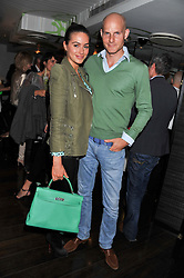 GUNNAR WINBERGH and his wife SASKIA BOXFORD at a party to celebrate the launch of Jax Coco - a new soft drink, held at Harvey Nichols 5th Floor Bar, 109-125 Knightsbridge, London on 25th June 2012.