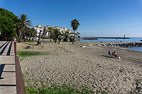 Spain, Malaga Province, Puerto Banus, beach, sun shinning, almost deserted, two people only, stranger on the shore, strangers on the shore, December, 2018, off season, low season, 201812100129<br /><br />Copyright Image from Victor Patterson, 54 Dorchester Park, <br />Belfast, UK, BT9 6RJ<br /><br />t1: +44 28 9066 1296 (from Rep of Ireland 048 9066 1296)<br />t2: +44 28 9002 2446 (from Rep of Ireland 048 9002 2446)<br />m: +44 7802 353836<br /><br />victorpattersonbelfast@gmail.com<br /><br />Please see my Terms and Conditions of Use at victorpatterson.com. It is IMPORTANT that you familiarise yourself with them.<br /><br />Images used on the Internet incur an additional cost and must be visibly watermarked i.e. © Victor Patterson within the body of the image and copyright metadata must not be deleted. Images used on the Internet have a size restriction of 4kbs and are chargeable at rates available at victorpatterson.com.<br /><br />This image is available only for the use of the download recipient i.e. television station, newspaper, magazine, book publisher, etc, and must not be passed on to any third party. It is also downloaded on condition that each and every usage is notified within 7 days to victorpattersonbelfast@gmail.com<br /><br />The right of Victor Patterson (or the named photographer) to be identified as the author is asserted in accordance with The Copyright Designs And Patents Act (1988). All moral rights are asserted.