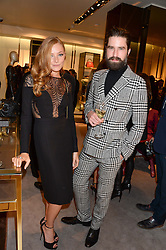 CLARA PAGET and JACK GUINNESS at a party hosted by Gucci & Clara Paget to drink a new cocktail 'I Bamboo You' held at Gucci, 34 Old Bond Street, London on 16th October 2013.