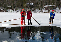 A beautiful day at Deep End Cove as volunteers David and CC White and Carol Poitras help out with the annual Ice Harvest for Rockywald Deephaven Camps.   (Karen Bobotas/for the Laconia Daily Sun)