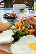 A typical Israeli breakfast as served in hotels, restaurants and caffes in Israel including eggs, cheeses, salads, bread or rolls and tea or coffee. In some places it is served 24 hours a day