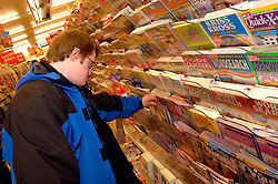Man with learning disabilities shopping; Bradford; Yorkshire UK