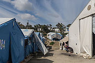The makeshift settlement next to the official Moria refugee camp site is home to an estimated 1500 asylum seekers. Scattered amongst the olive groves, people live in tents and shelters in this unofficial site.