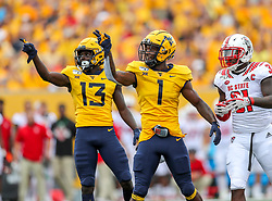 Sep 14, 2019; Morgantown, WV, USA; West Virginia Mountaineers wide receiver T.J. Simmons (1) celebrates a first down catch during the first quarter against the North Carolina State Wolfpack at Mountaineer Field at Milan Puskar Stadium. Mandatory Credit: Ben Queen-USA TODAY Sports
