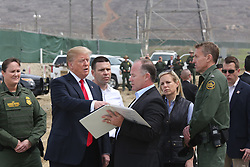 March 13, 2018 - San Diego, CA, United States of America - U.S President Donald Trump is show prototypes of the proposed border wall with Mexico by site Manager Jim O'Loughlin, as Acting CBP Commissioner Kevin McAleenan and Homeland Secretary Kirstjen Nielsen look on at the Otay Mesa Port of Entry March 13, 2018 in San Diego, California. (Credit Image: © Cbp/Planet Pix via ZUMA Wire)