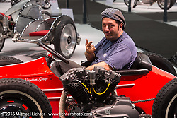Daniele in his  4-wheeler sidecar named Scooter powered by a Harley-Davidson Ironhead Sportster built by Emporium Garage Bergamo in Italy on display at the Intermot Motorcycle Trade Fair. Cologne, Germany. Tuesday October 4, 2016. Photography ©2016 Michael Lichter.