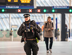 © Licensed to London News Pictures. 27/03/2020. London, UK. Police patrol Waterloo Station, London as Prime Minister Boris Johnson orders police to enforced the lockdown with fines being given out to people for travelling in to London without good reason as the coronavirus crisis continues. Photo credit: Alex Lentati/LNP