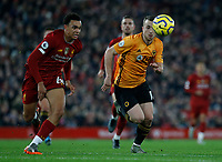 Football - 2019 / 2020 Premier League - Liverpool vs. Wolverhampton Wanderers<br /> <br /> Trent Alexander-Arnold of Liverpool pursues Diogo Jota of Wolves, at Anfield.<br /> <br /> COLORSPORT/ALAN MARTIN