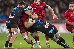 March 23, 2019 - Limerick, Ireland - Fineen Wycherley of Munster tackled by Renato Giammarioli and Oliviero Fabiani of Zebre during the Guinness PRO14 match between Munster Rugby and Zebre at Thomond Park Stadium in Limerick, Ireland on March 23, 2019  (Credit Image: © Andrew Surma/NurPhoto via ZUMA Press)