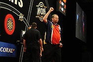 Raymond van Barneveld of Holland celebrates against James Wade. McCoy's Premier league darts, week 7 event at the Motorpoint Arena in Cardiff, South Wales on Thursday 21st March 2013. pic by Andrew Orchard, Andrew Orchard sports photography,