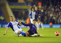 Bristol Rovers' Oliver Norburn tackles Birmingham City's Oliver Lee - Photo mandatory by-line: Joe Meredith/JMP - Tel: Mobile: 07966 386802 14/01/2014 - SPORT - FOOTBALL - St Andrew's Stadium - Birmingham - Birmingham City v Bristol Rovers - FA Cup - Third Round