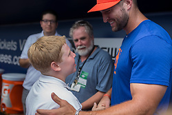 August 10, 2017 - Florida, U.S. - CHARLIE KAIJO   |   Times.Tim Tebow greets young journalist Eli Fishman, 13, of Maplewood, NJ. following a press conference at Steinbrenner Field Tampa, Fla. on Thursday, August 10, 2017. (Credit Image: © Charlie Kaijo/Tampa Bay Times via ZUMA Wire)