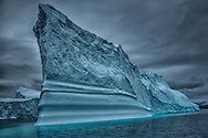 Giant icebergs convey the quintessential essence of Greenland and their forbidding environment.