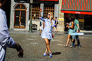 Today 2nd of August was the hottest day of this summer until now. This fancy female tourist in the very center of Brussels didn't seem to mind and used the sun to picture herself while being on the phone. 20130801 ©sanderdewilde.com