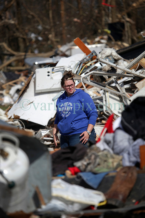 24 February 2016. Sugar Hill RV Park, Convent, Louisiana.<br /> Scenes of devastation following a deadly EF2 tornado touchdown. 2 confirmed dead. <br /> Meagan Thomas works with her family to recover all they can from their destroyed trailer.<br /> Photo©; Charlie Varley/varleypix.com