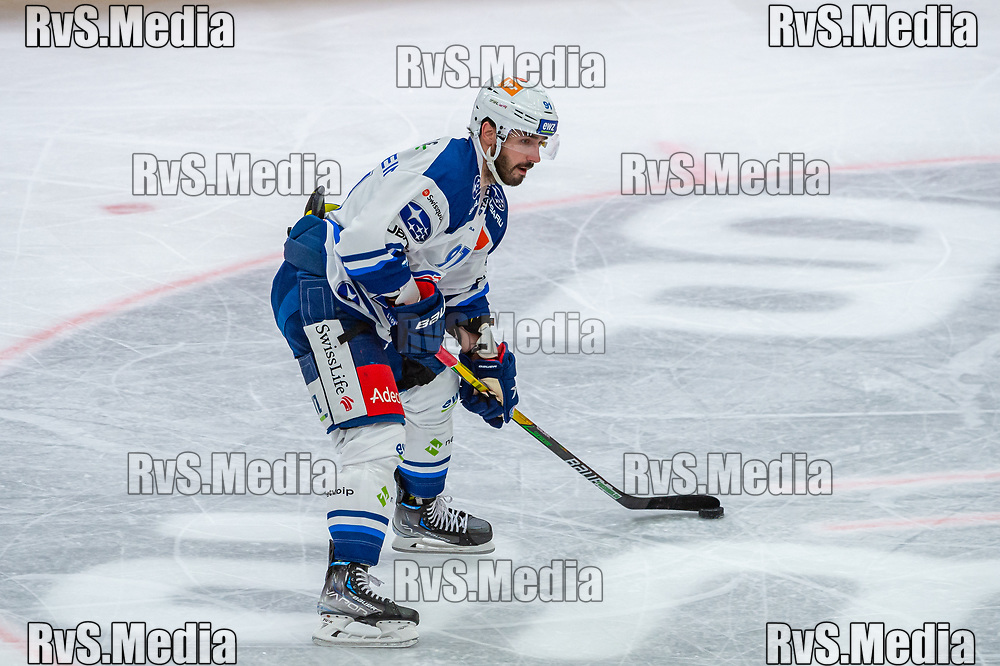 LAUSANNE, SWITZERLAND - OCTOBER 01: Denis Hollenstein #91 of ZSC Lions in action during the Swiss National League game between Lausanne HC and ZSC Lions at Vaudoise Arena on October 1, 2021 in Lausanne, Switzerland. (Photo by Robert Hradil/RvS.Media)