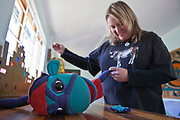 Brigid Schutz fixes Mac the Monkey's hand before a puppet performance. Birgid is one of the directors of AREPP: Theatre for Life that provides interactive social life skills education to school children through theatre productions.  They are based in Johannesburg, South Africa and are about to go on tour for 3 months doing performances everyday at schools across the country.
