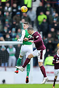 Oli Shaw (#32) of Hibernian wins a header against Aaron Hughes (#5) of Heart of Midlothian during the William Hill Scottish Cup 4th round match between Heart of Midlothian and Hibernian at Tynecastle Stadium, Gorgie, Scotland on 21 January 2018. Photo by Craig Doyle.