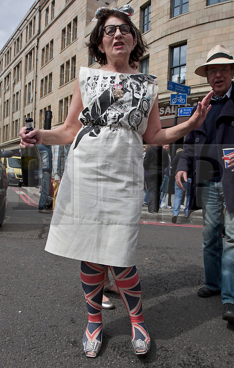 © Licensed to London News Pictures. 04/06/2012. London, England. .Landlady Sandra Esquilant of the Golden Heart Pub has A traditional East End street party celebrating the Diamond Jubilee in the Spitalfields area of London..The Royal Jubilee celebrations. Great Britain is celebrating the 60th  anniversary of the countries Monarch HRH Queen Elizabeth II accession to the throne this weekend Photo credit : RICH BOWEN/LNP