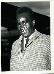 Mar. 03, 1960 - Northenn Rhodesia Nationalist Leader Arrive Mr. Kenneth Kaunda.. Mr. Kennetha Kaunda Leader of the Nationalists in Northen Rhodesia -arrived at London Airport this morning -Following a cable from his countrymen - now here for next weeks talks on the Central African Federantion. Mr. Kaunda is expected to be one of the Key figures in thenegtions - but has said that he will not attend the talks unless he is satisfied about the conditions on which discussions of the future of Northern Rhodesis will be held. Keystone Photo Shows:- Mr. Kenneth Kaunda on his arrival at London Airport this morning. (Credit Image: © Keystone Press Agency/Keystone USA via ZUMAPRESS.com)