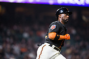 San Francisco Giants left fielder Andrew McCutchen (22) runs to first base on a hit against the Oakland Athletics at AT&T Park in San Francisco, California, on March 26, 2018. (Stan Olszewski/Special to S.F. Examiner)