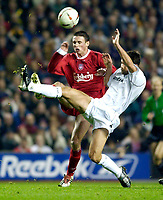 Photo. Jed Wee.<br /> Liverpool v Bolton Wanderers, Carling Cup, Anfield, Liverpool. 03/12/03.<br /> Bolton's Emerson Thome (R) sticks out a leg to deny Liverpool's Anthony Le Tallec.